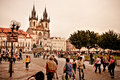 Street view in prague with crowds strolling around an open square backed by historical buildings toned image Royalty Free Stock Photo
