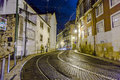 Streetcar rails in the old part lisbon portugal dec lisbon at night streets with and houses on december lisbon portugal first Stock Photo