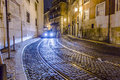 Streetcar rails in the old part lisbon portugal dec lisbon at night streets with and houses on december lisbon portugal first Stock Image