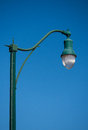 Streetlamp a nice and elegant isolated against a clear blue sky Stock Images