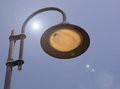 Streetlamp and sun flare in art nouveau or art deco design with blue sky Royalty Free Stock Photos