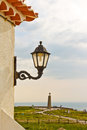 Streetlamp and a view of cabo da roca cape roca streetlight on wall westernmost extent european continent Royalty Free Stock Photos