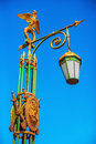 Streetlight with a gilded two-headed eagle in St. Petersburg Royalty Free Stock Photo