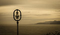 Streetlight over the sea in village of lastres spain Royalty Free Stock Photos