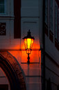 Streetlight in prague burning at night on the building the czech republic Royalty Free Stock Photo
