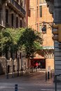 Streets of Barcelona. A view from Via Laietana to a street with buildings, trees and box office. Royalty Free Stock Photo