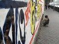 Streets of Kolkata, man squatting on street Royalty Free Stock Photo
