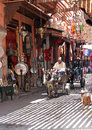 The streets of marrakech a narrow alley marrakesch a man leads a cart pulled by a donkey among small shops city Royalty Free Stock Images