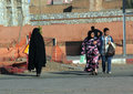 The streets of marrakech women one them is completely covered by a black veil Royalty Free Stock Photography