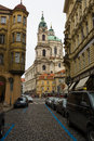 The streets of old prague saint nicholas cathedral czech republic february Stock Photo