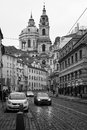 The streets of old prague saint nicholas cathedral czech republic february stylized film large grains black and white Royalty Free Stock Photos