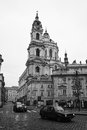 The streets of old prague saint nicholas cathedral czech republic february stylized film large grains black and white Stock Photos