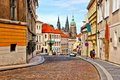 Streets of prague street in the old town with st vitus cathedral in background Royalty Free Stock Images