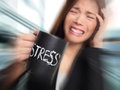 Stress business person stressed at office woman holding coffee cup with written overworked and over caffeinated Royalty Free Stock Photos