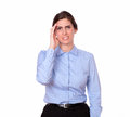 Stress gorgeous woman looking at you a portrait of a on blue blouse with headache on isolated studio Royalty Free Stock Photos