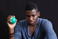 Stress stressed man with a ball and frowning expression Royalty Free Stock Photo
