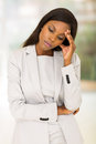 Stressed african american woman standing indoors Royalty Free Stock Photos