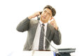 Stressed asian businessman office worker talking on the phone Stock Image