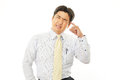 Stressed asian businessman tired and Royalty Free Stock Photo
