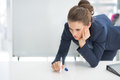 Stressed business woman near flipchart in office Royalty Free Stock Photos