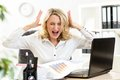 Stressed business woman screaming loudly working at laptop in office Royalty Free Stock Image