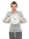 Stressed business woman showing clock Royalty Free Stock Photos