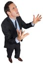 Stressed businessman gesturing on white background Stock Photo