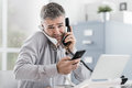 Stressed businessman having multiple calls Royalty Free Stock Photo