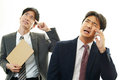 Stressed businessmen dissatisfied with a phone Royalty Free Stock Image