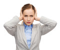 Stressed businesswoman with covered ears Stock Image