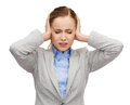 Stressed businesswoman with covered ears busienss emotions and office concept and closed eyes Royalty Free Stock Photo