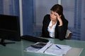 Stressed businesswoman working in office Royalty Free Stock Photo