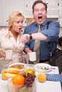 Stressed Couple in Kitchen Late for Work Royalty Free Stock Images