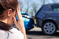 Stressed driver sitting at roadside after traffic accident female Stock Images