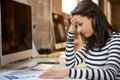 Stressed Female Designer Works At Computer In Modern Office