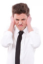 Stressed guy covering his ears, too much noise Royalty Free Stock Photos