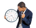 Stressed guy running out of time a closeup portrait a business man executive leader holding a clock very determined pressured by Stock Photos