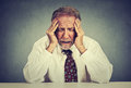Stressed hopeless elderly business man in depression sitting at the office table Royalty Free Stock Photo