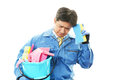 Stressed janitorial the male worker who is tired on white background Royalty Free Stock Image