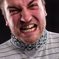 Stressed man iron chain around neck Stock Photos