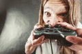 Stressed man playing on pad addiction depressed young gaming angry guy with controller play console face expression Stock Images