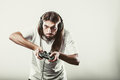 Stressed man playing on pad addiction depressed young gaming angry guy with controller play console face expression Royalty Free Stock Photos