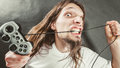 Stressed man playing on pad Royalty Free Stock Photo