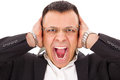Stressed man screaming holding his head with expression Stock Photo