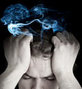 Stressed man with smoking head Stock Photo