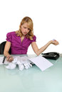 Stressed office worker at her desk Stock Photo