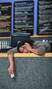 Stressed out cafe owner worker laying on counter Stock Image