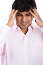Really stressed out guy with headache closeup portrait of wearing pink shirt isolated on white background Royalty Free Stock Photo