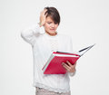 Stressed pretty young woman working with documents and having headache in white blouse a over white background Royalty Free Stock Images