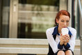 Stressed sad young woman sitting outdoors corporate office Royalty Free Stock Photo
